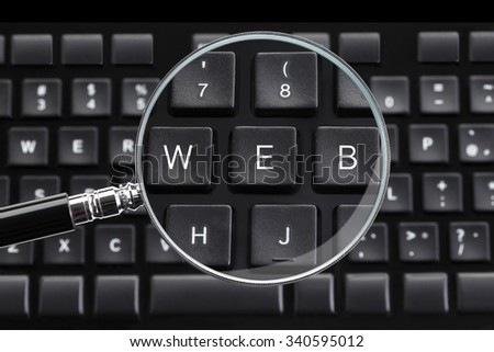 WEB written on keyboard with magnifying glass