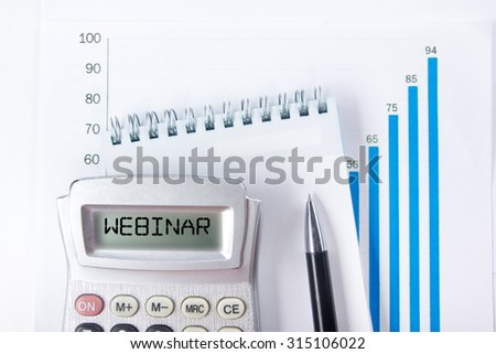 Webinar - Financial accounting stock market graphs analysis. Calculator, notebook with blank sheet of paper, pen on chart. Top view - stock photo
