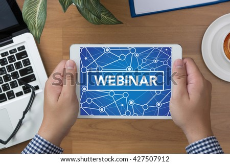 WEBINAR man hand Tablet and coffee cup - stock photo