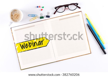 Webinar text on notebook with copy space - stock photo