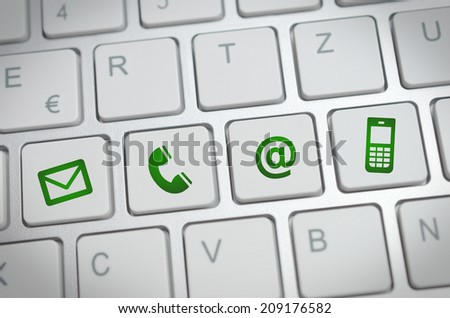 Website and Internet contact us page concept with green contact icons and symbols - stock photo