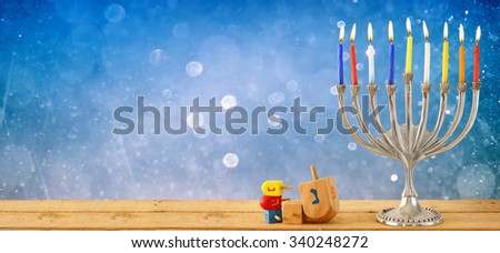 website banner image of of jewish holiday Hanukkah with menorah (traditional Candelabra). retro filtered. glitter overlay - stock photo