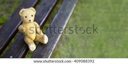 Website banner of a toy bear as giving his paw - hope concept - stock photo