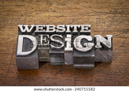 website design text in mixed vintage metal type printing blocks over grunge wood - stock photo