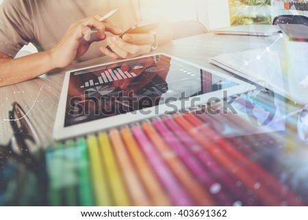 Website designer working digital tablet and computer laptop with smart phone and digital design diagram on wooden desk as concept