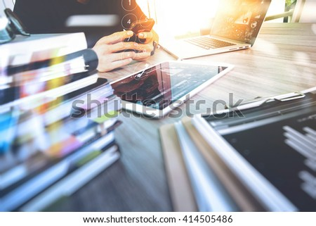 Website designer working digital tablet and computer laptop with smart phone and digital design diagram and stack of books on wooden desk as concep - stock photo