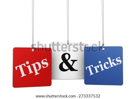 Website, Internet and blog concept with tips & tricks word and sign on hanged tags isolated on white background. - stock photo