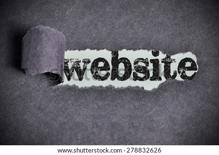 Website word under torn black sugar paper. - stock photo