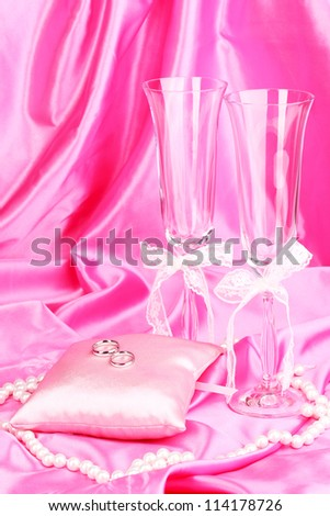 Wedding accessories on pink cloth background - stock photo