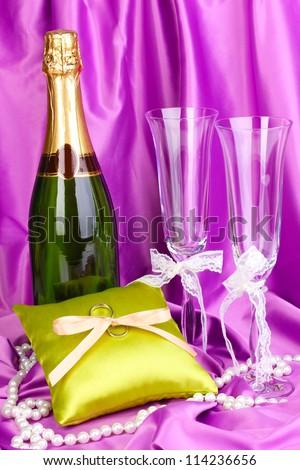Wedding accessories on purple cloth background - stock photo