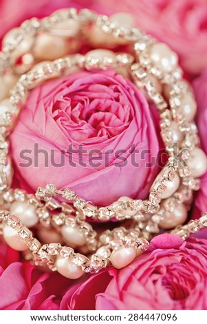 Wedding accessories to hairstyle on tenderness rose background. Hand made hair-pin. - stock photo