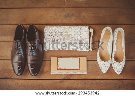 Wedding accessories, wedding shoes on a brown wooden background - stock photo