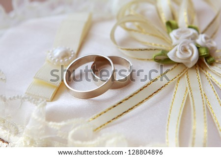 Wedding accessory. Heart-shaped pillow with wedding rings - stock photo
