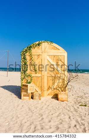 wedding arch and set up on beach - stock photo