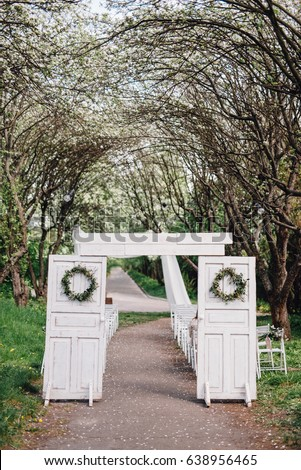 Wedding Arch From White Doors Decorated With Wreaths Standing In Ceremony Zone Rustic Style Located