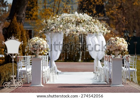 Wedding arch in the garden - stock photo