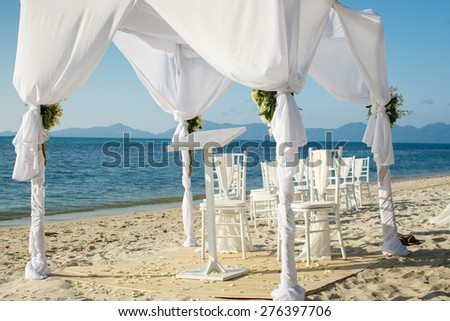 Wedding arch on the beach - stock photo