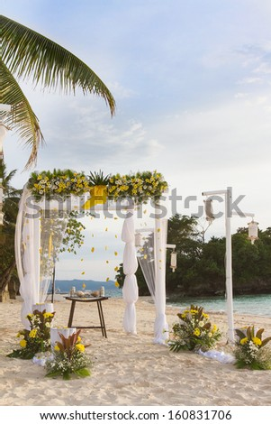 wedding arch - tent - decorated with flowers on beach, tropical wedding ceremony set up - stock photo