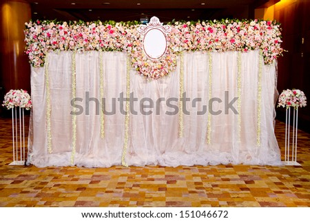 Wedding archway with flowers arranged in hotel for a wedding ceremony  - stock photo