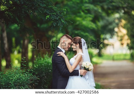Wedding as a source of satisfaction. Groom and bride together. Bridal couple on wedding day. - stock photo