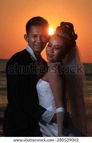 wedding at sunset or sunrise - stock photo