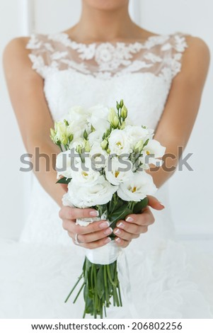 Wedding. Attractive bride with beautiful bouquet - stock photo