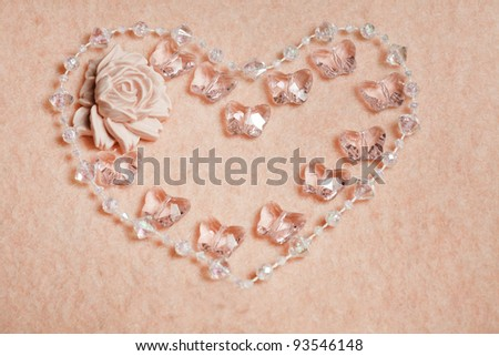 Wedding background with rose and beads - stock photo