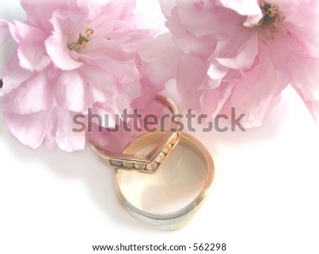 wedding bands and cherry blossom flowers