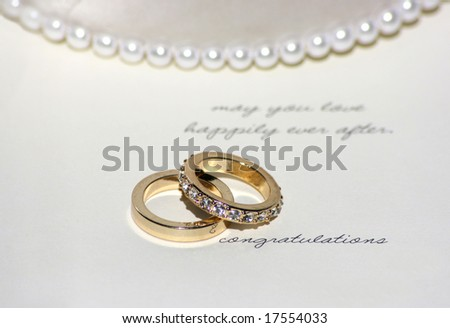 "wedding bands on a card saying ""congratulations"""