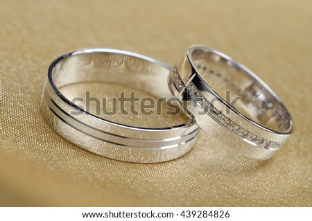 Wedding bands on golden satin