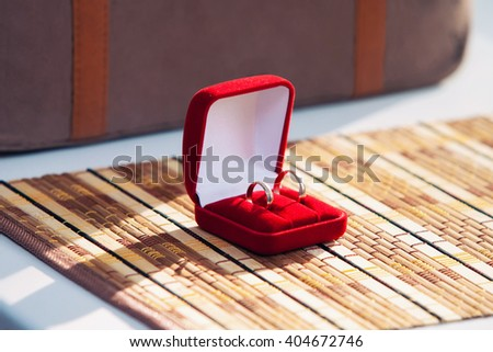wedding bands, wedding rings in the red box, wedding jewelry - stock photo