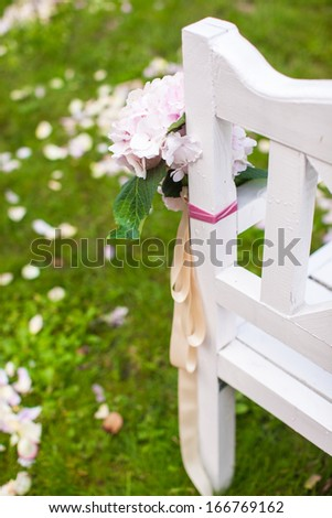 Wedding benches and flower for ceremony outdoors - stock photo