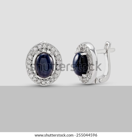 Wedding Blue stone and Diamond Earring on color background - stock photo