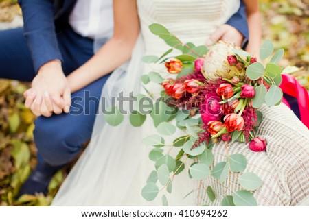 wedding boho bouquet with eucalyptus, tulips, protea and roses - stock photo