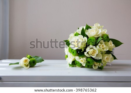 Wedding bouquet and boutonniere of white flowers - stock photo