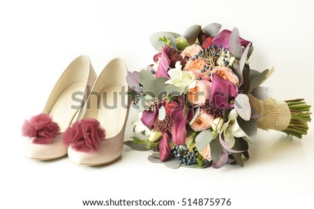 Wedding bouquet and bride's shoes, white background, isolated.