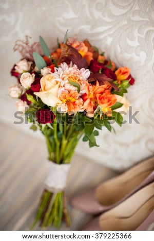 wedding bouquet and bridesmaid shoes on the brown mat