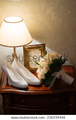 wedding bouquet and shoes on the nightstand - stock photo