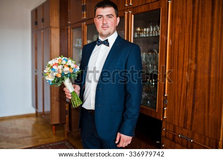 wedding bouquet at hand of groom