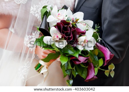 Wedding bouquet. Bride's traditional symbolic accessory. Floral composition with Calla lilies flowers.