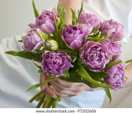 Wedding bouquet in bride's hands - stock photo