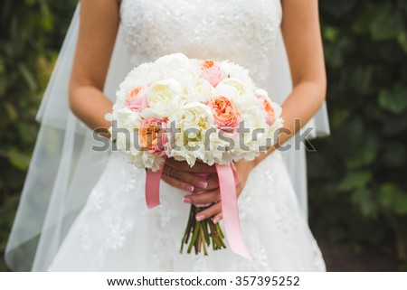 wedding bouquet in the bride's hands - stock photo