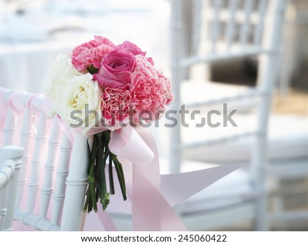 Wedding bouquet in wedding chair vintage color tone - stock photo