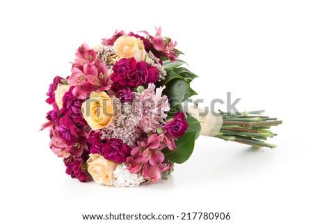 Wedding bouquet lying down on white background. - stock photo