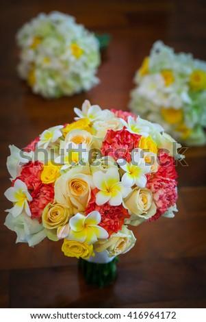 Wedding bouquet lying on wooden floor in bride room. - stock photo