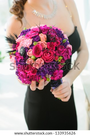 Wedding bouquet of beautiful colorful roses for bride - stock photo