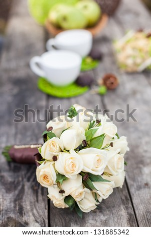 Wedding bouquet of bride on table - stock photo