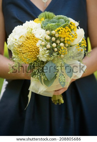 Wedding bouquet of flowers in hands of bridesmaid  - stock photo