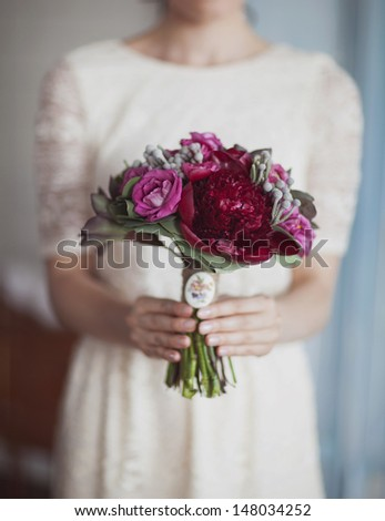 Wedding bouquet of red and pink roses and peonies - stock photo
