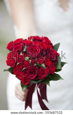 wedding bouquet of red roses and leaves